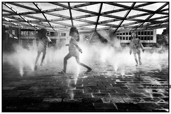 Around And Around Spray Fountains :: Black and white urban street photography - Artwork © Michel Godts
